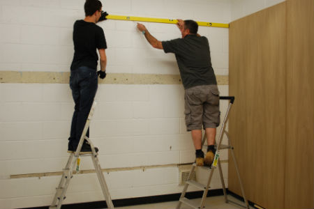 Construction students help renovate college gym