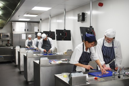 Catering students learn to fillet fish
